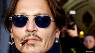 FILE PHOTO: Actor Johnny Depp leaves the High Court in London