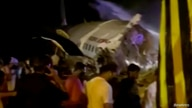 A passenger plane that crashed after it overshot the runway is seen at Calicut International Airport in Karipur