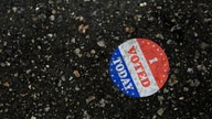 """An """"I voted today"""" sticker is seen on the ground at Philadelphia's City Hall, an early voting location for the upcoming presidential election, in Philadelphia, Pennsylvania"""