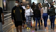 People walk at a mall during the Black Friday sales in Caracas
