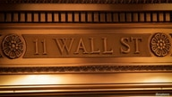 A sign is seen outside the 11 Wall St. entrance of the NYSE in New York