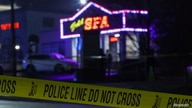Crime scene tape surrounds Aromatherapy Spa after deadly shootings at spas in Atlanta