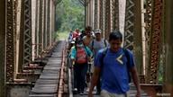 FILE PHOTO: A group of migrants from Honduras walk along the railway track on their way to the United States in Huimanguillo