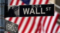 A Wall Street sign is pictured outside the New York Stock Exchange in New York