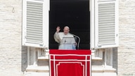 Pope Francis leads the Regina Coeli prayer from his window at St. Peter's Square