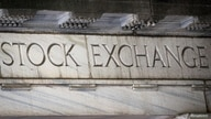 FILE PHOTO: An entrance to the NYSE on Wall Street in New York