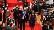 El Salvador's President Nayib Bukele leaves with First Lady Gabriela de Bukele after delivering a speech to the country to mark his second year in office, in San Salvador