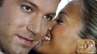 """FILE PHOTO: Actor Ben Affleck, star of the new action film """"Daredevil"""" listens to his fiancee, actress Jennifer .."""