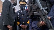 Haitian National Police chief, Leon Charles, inspects the final preparations for the funeral of slain Haitian President Jovenel Moise in Cap-Haitien
