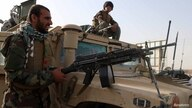 Afghan National Army soldiers keep watch at checkpoint in Guzara district of Herat province
