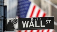A street sign for Wall Street is seen outside the New York Stock Exchange (NYSE) in New York City