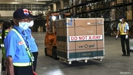 A forklift is used to transport Moderna vaccines against the coronavirus disease