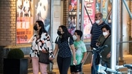 People wear masks to prevent against the spread of the coronavirus disease (COVID-19) in New York