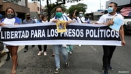 Nicaraguans exiled in Costa Rica take part in a march against the Government of Nicaraguan President Daniel Ortega and the upcoming November 7 general elections, in San Jose