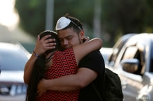 A couple react after El Salvador's President Nayib Bukele ordered the closing of the airport, as the government undertakes…