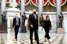 U.S. House Majority Leader Steny Hoyer (D-MD) wears a face mask as he walks to the House Chamber ahead of a vote on an…