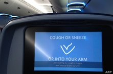 A video invites passengers to safely cough in their elbows before a Delta flight departs from Minneapolis–Saint Paul…