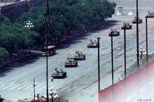 FILE PHOTO 5JUN89 - A Peking citizen stands passively in front of tanks on the Avenue of Eternal Peace in this June 5, 1989,…