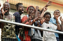 Migrants of the immigrant center CETI welcomes newly arrived African immigrants in the Spanish enclave Ceuta, after some 200…