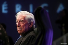 """Peruvian Nobel Prize winner writer Mario Vargas Llosa looks on during a launching ceremony of his new book """"Tiempos Recios"""" at…"""