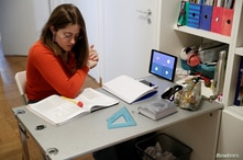 Lavinia Tomassini, 14, uses her iPad to take part in an online French class, as part of a home-schooling programme put in place…