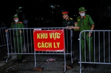 Police and soldiers remove barriers as the quarantine is lifted in Dong Cuu village, the last Vietnamese village affected by…
