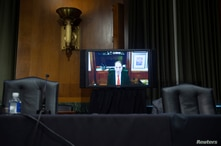 """Ranking member Ron Wyden (D-OR) speaks by video conference during a Senate Finance Committee hearing on """"COVID-19 and Beyond:…"""
