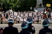 Demonstrators hold a Black Lives Matter banner during a protest against racial inequality in the aftermath of the death in…