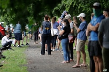 People wait in a line to vote in the Georgia's primary election at Park Tavern on Tuesday, June 9, 2020, in Atlanta. (AP Photo…