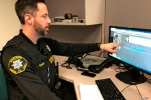 FILE - In this Feb. 22, 2019, file photo, Washington County Sheriff's Office Deputy Jeff Talbot demonstrates how his agency…
