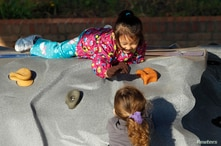 Four-year old Catherine Mawi (top) plays with three-year old Lillian Barnette (bottom) at the Frederick, Maryland Head Start…