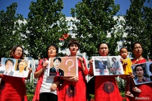 """Relatives of those detained in what is known as the """"709"""" crackdown protest in front of the Supreme People's Procuratorate in…"""