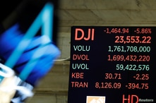 The Dow Jones Industrial Average is displayed after the closing bell on the floor of the New York Stock Exchange (NYSE) in New…