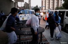 Guatemalan migrants are accompanied by Guatemalan government officials after being deported from the U.S. outside Guatemala's…