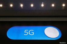 An advertising board shows a 5G logo at the International Airport in Zaventem, Belgium May 4, 2020. Picture taken May 4, 2020…