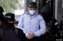 El Salvador's former Minister of Defense David Munguia Payes leaves the courthouse after his detention on suspicion of unlawful…