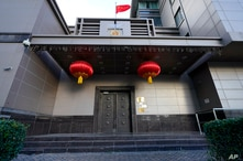 The flag of China flies outside the Chinese Consulate General Wednesday, July 22, 2020, in Houston.