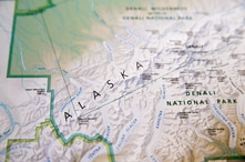 A National Park Service map depicting the newly renamed Denali is shown on Monday, Aug. 31, 2015, aboard Air Force One before a…