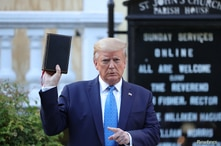 U.S. President Donald Trump holds up a Bible during a photo opportunity in front of St. John's Episcopal Church in the midst of…