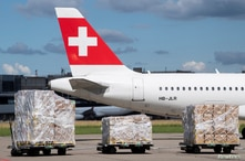 """Tons of relief supplies of the """"Humanitarian Help of Switzerland"""" wait at the Zurich Airport to be loaded onto a cargo plane…"""