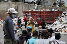 People gather in the low income neighbourhood of Petare amid the outbreak of the coronavirus disease (COVID-19), in Caracas,…