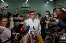 Alexander Murakhovsky, chief doctor of a hospital, where Alexei receives medical treatment, speaks with the media in Omsk,…