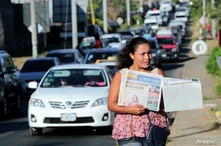 A street vendor sells La Prensa, a local newspaper showing a blank front page as a sign of protest against Daniel Ortega's…