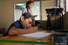 A boy does his homework after the closing of schools during the nationwide quarantine due to coronavirus disease (COVID-19)…