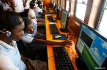 Colombian students learn how to use computers in the ship 'El Navegante del Pacifico' in the port city of Tumaco, by the…