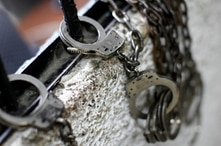 Handcuffs are attached to bars at an unidentified prison in Caracas August 15, 2011. Venezuela's prisons are notorious for ease…