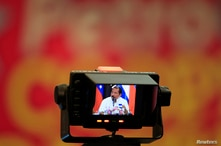 Nicaragua's President Daniel Ortega is seen on a TV camera screen as he speaks during a meeting of countries in Venezuela's…
