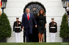 U.S. President Donald Trump and first lady Melania Trump arrive to observe a moment of silence to mark the 18th anniversary of…