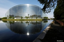 FILE PHOTO: The building of the European Parliament, designed by Architecture-Studio architects, is seen in Strasbourg, France,…