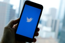 FILE PHOTO: The Twitter App loads on an iPhone in this illustration photograph taken in Los Angeles, California, U.S., July 22,…
